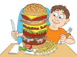 Hamburger yiyen çocuk